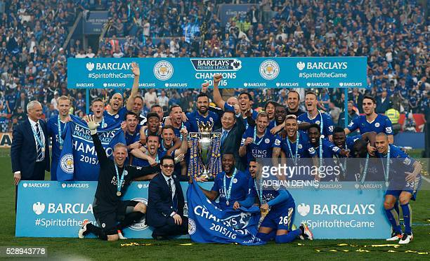 Leicester players celebrate with Leicester City's Thai chairman Vichai Srivaddhanaprabha with the Premier league trophy after winning the league and...