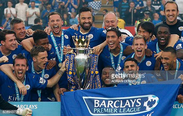 Leicester players celebrate with the Premier league trophy after winning the league and the English Premier League football match between Leicester...