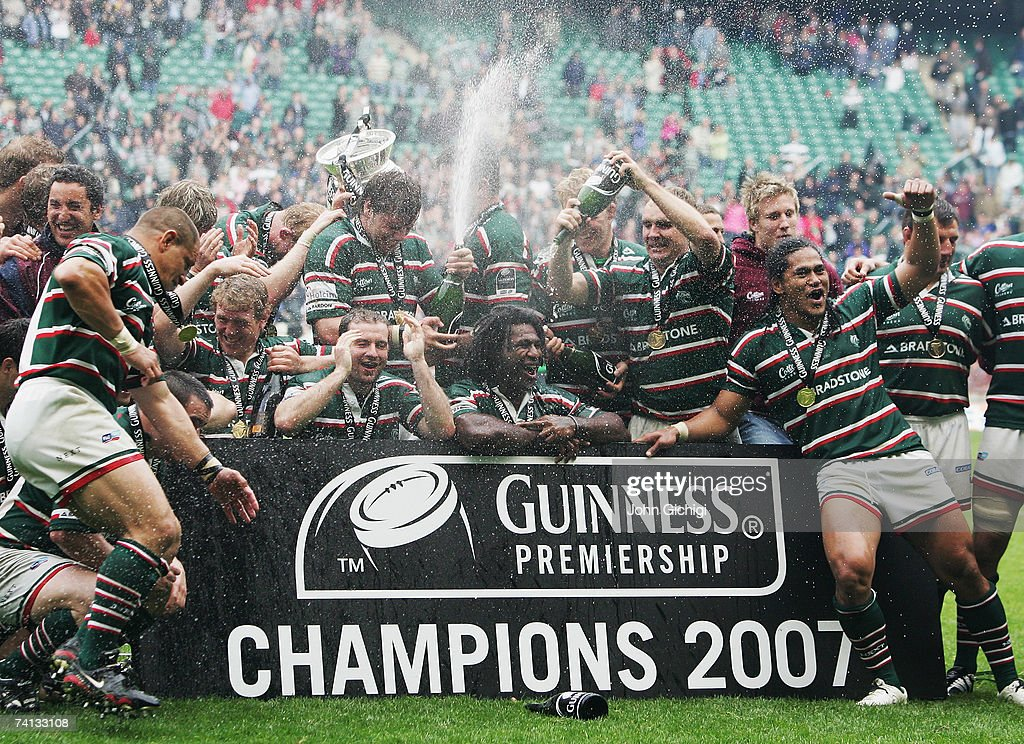 Leicester players celebrate with the trophy following their victory during the Guinness Premiership final between Gloucester and Leicester Tigers at Twickenham on May 12, 2007 in London, England.
