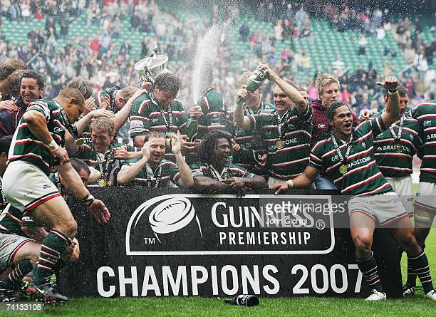 Leicester players celebrate with the trophy following their victory during the Guinness Premiership final between Gloucester and Leicester Tigers at...