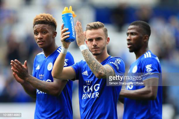 Leicester players Demarai Gray James Maddison and Kelechi Iheanacho applaud the support after the Premier League match between Leicester City and...