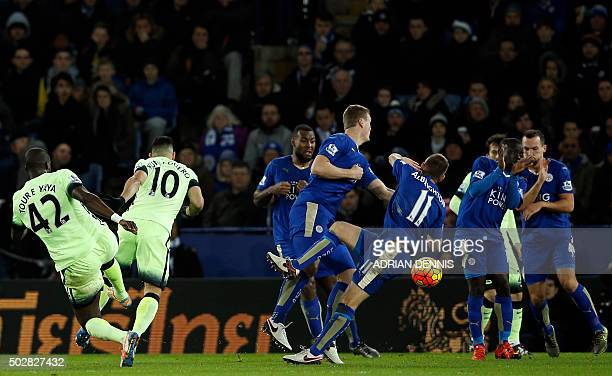 Leicester players manage to block a fierce shot from Manchester City's Ivorian midfielder and captain Yaya Toure during the English Premier League...
