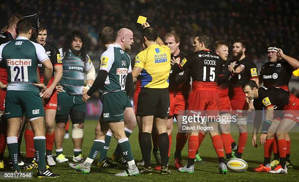 Leicester prop Dan Cole is shown the yellow card by referee Greg Garner during the Aviva Premiership match between Saracens and Leicester Tigers at...