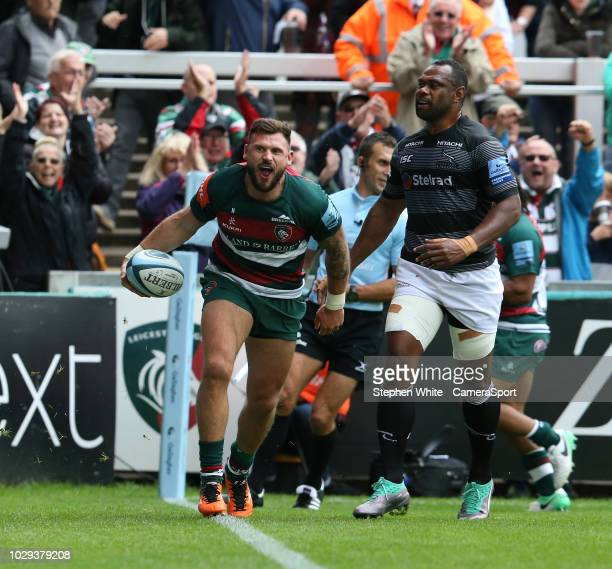 Leicester Tigers' Adam Thompstone celebrates scoring his side's third try during the Gallagher Premiership Rugby match between Leicester Tigers and...