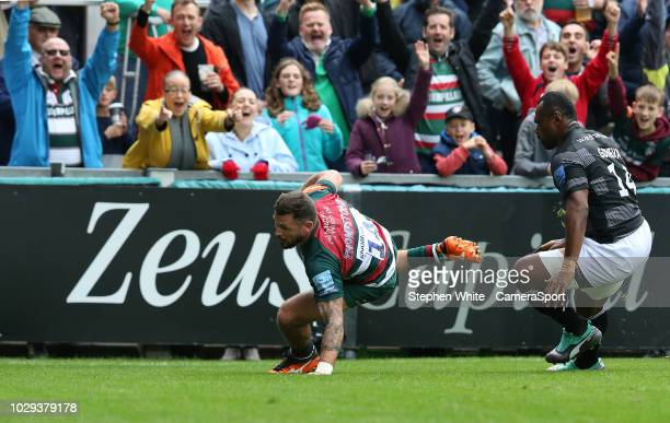 Leicester Tigers' Adam Thompstone scores his side's third try despite the attentions of Newcastle Falcons' Vereniki Goneva during the Gallagher...