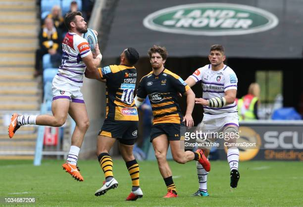 Leicester Tigers' Adam Thompstone wrestles the ball away from Wasps' Lima Sopoaga during the Gallagher Premiership Rugby match between Wasps and...