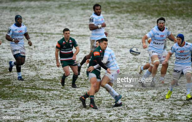 Leicester Tigers centre Matt Toomua offloads in the tackle during the European Rugby Champions Cup match between Leicester Tigers and Racing 92 at...