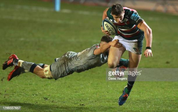 Leicester Tigers fullback Freddie Steward is tackled by Sale Sharks forward Sam Dugdale during the Gallagher Premiership Rugby match between...
