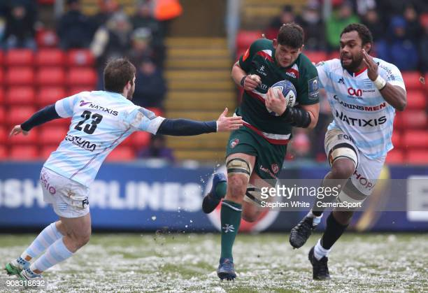 Leicester Tigers' Mike Williams is tackled by Racing 92's Louis Dupichot and Leone Nakarawa during the European Rugby Champions Cup match between...