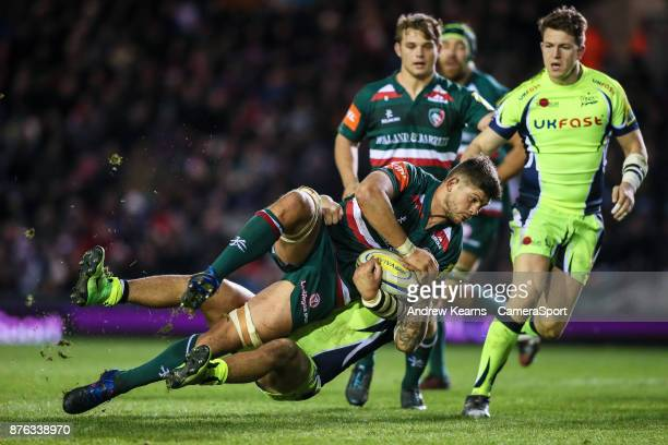 Leicester Tigers' Mike Williams is tackled by Sale Sharks' Sam James during the Aviva Premiership match between Leicester Tigers and Sale Sharks at...