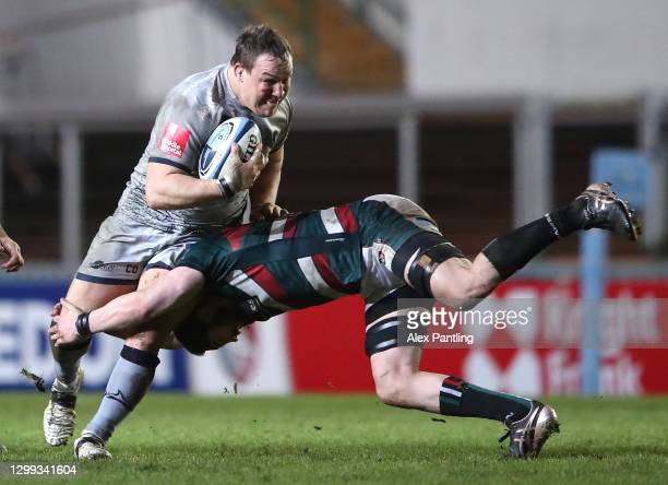 Leicester Tigers player Cyle Brink tackles Sale Sharks forward Coenie Oosthuizen during the Gallagher Premiership Rugby match between Leicester...