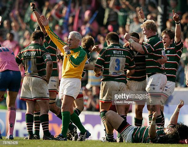 Leicester Tigers players celebrate as referee Allan Lewis blows the final whistle after their victory in the Heineken Cup quarter final match between...