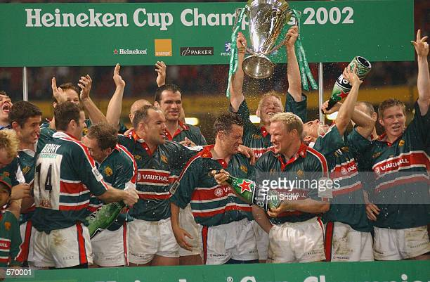 Leicester Tigers players celebrate winning the trophy during the Heineken Cup Final between Leicester Tigers and Munster at the Millennium Stadium,...