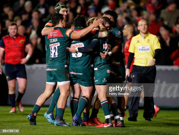 Leicester Tigers players congratulate Mathew Tait on his try during the European Rugby Champions Cup match between Leicester Tigers and Munster Rugby...