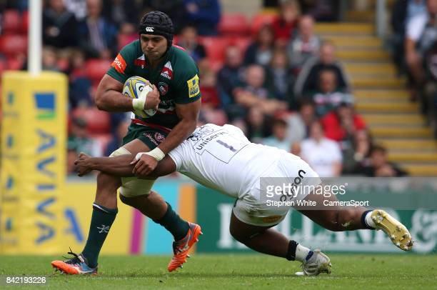 Leicester Tigers' Sione Kalamafoni is tackled by Bath Rugby's Beno Obano during the Aviva Premiership match between Leicester Tigers and Bath Rugby...