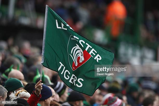 Leicester Tigers supporter waves a flag during the AngloWelsh Cup match between Leicester Tigers and Northampton Saints at Welford Road Stadium on...