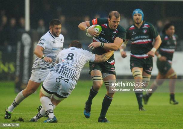 Leicester Tigers' Tom Croft is tackled by Ospreys' Dan Baker during the preseason friendly match between Ospreys and Leicester Tigers at Brewery...