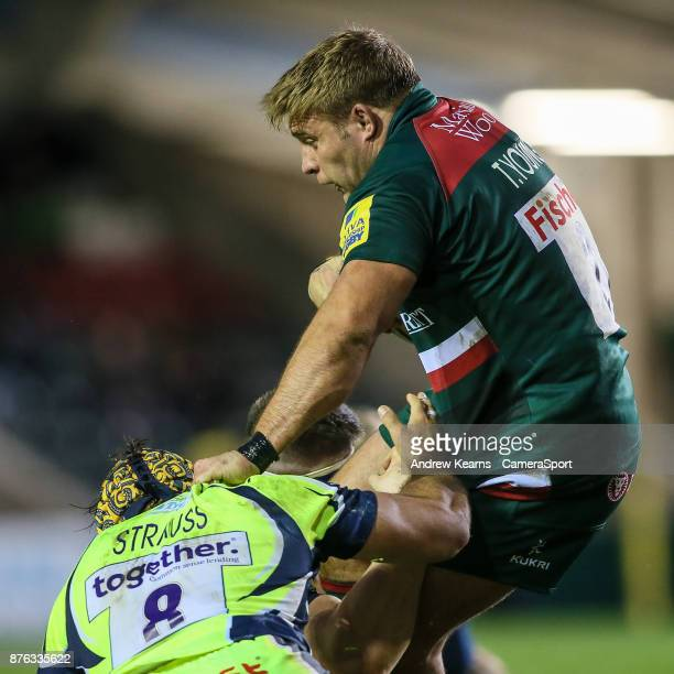 Leicester Tigers' Tom Youngs grapples with Sale Sharks' Josh Strauss during the Aviva Premiership match between Leicester Tigers and Sale Sharks at...