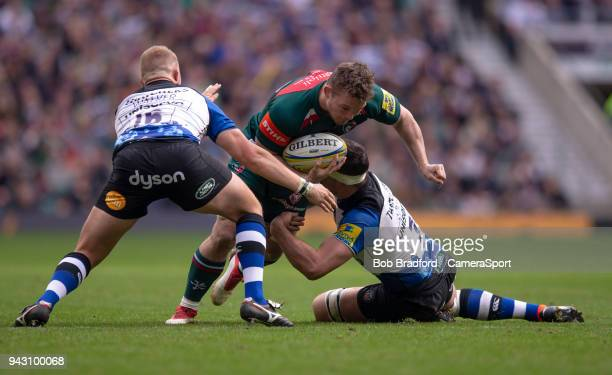 Leicester Tigers' Will Evans is tackled by Bath Rugby's Francois Louw and Jack Walker during the Aviva Premiership match between Bath Rugby and...