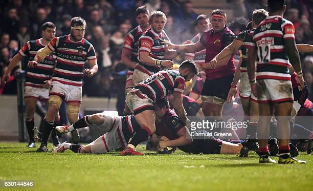 Leicester United Kingdom 17 December 2016 Niall Scannell of Munster scores his side's first try despite the efforts of Owen Williams of Leicester...