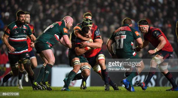 Leicester United Kingdom 17 December 2017 CJ Stander of Munster is tackled by Graham Kitchener of Leicester Tigers during the European Rugby...