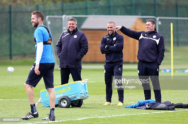 Leicester's assistant manager Craig Shakespeare shares a joke with coach Kevin Phillips and Physic Dave Rennie during the Leicester City training...