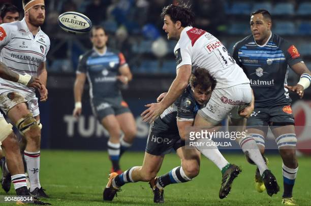 Leicester's centre Matt Smith passes the ball during the European Champions Cup rugby union match between Castres Olympique and Leicester Tigers at...
