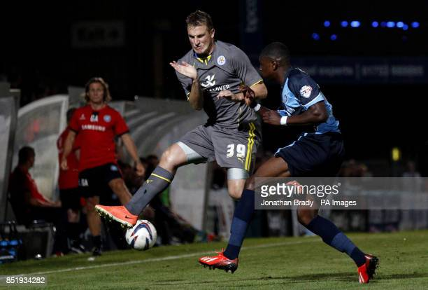 Leicester's Chris Wood braces himself in the air against the clearance from Wycombe's Kortney Hause during the Capital One Cup First Round match at...