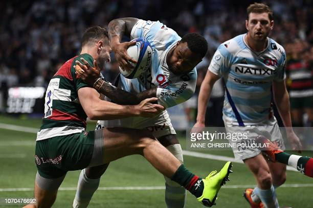 Leicester's Englsih winger Jonny May vies with Racing 92's New Zealandborn French wing Virimi Vakatawa during the European Rugby Champions Cup union...