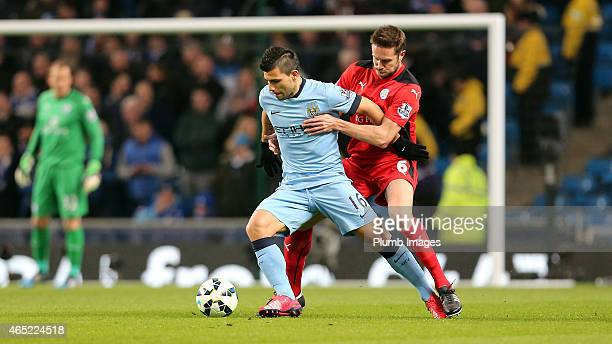 Leicester's Matthew Upson battles Manchester City's Sergio Aguero during the Premier League match between Manchester City and Leicester City at...