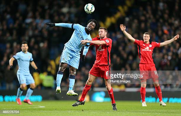 Leicester's Matthew Upson battles Manchester City's Wilfried Bony during the Premier League match between Manchester City and Leicester City at...