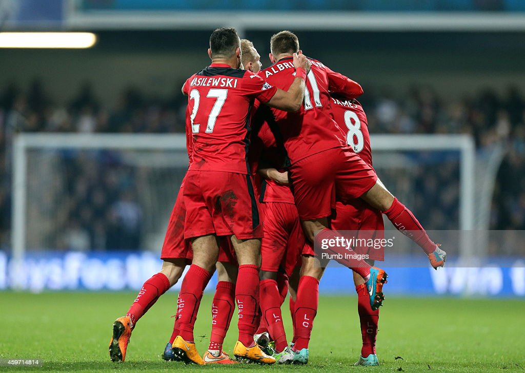 Leicester's players celebrate Jeff Schlupp's goal to make it 2-2 during the Barclays premier League match between Queens Park Rangers and Leicester City at Loftus Road on November 29, 2014 in London, England.