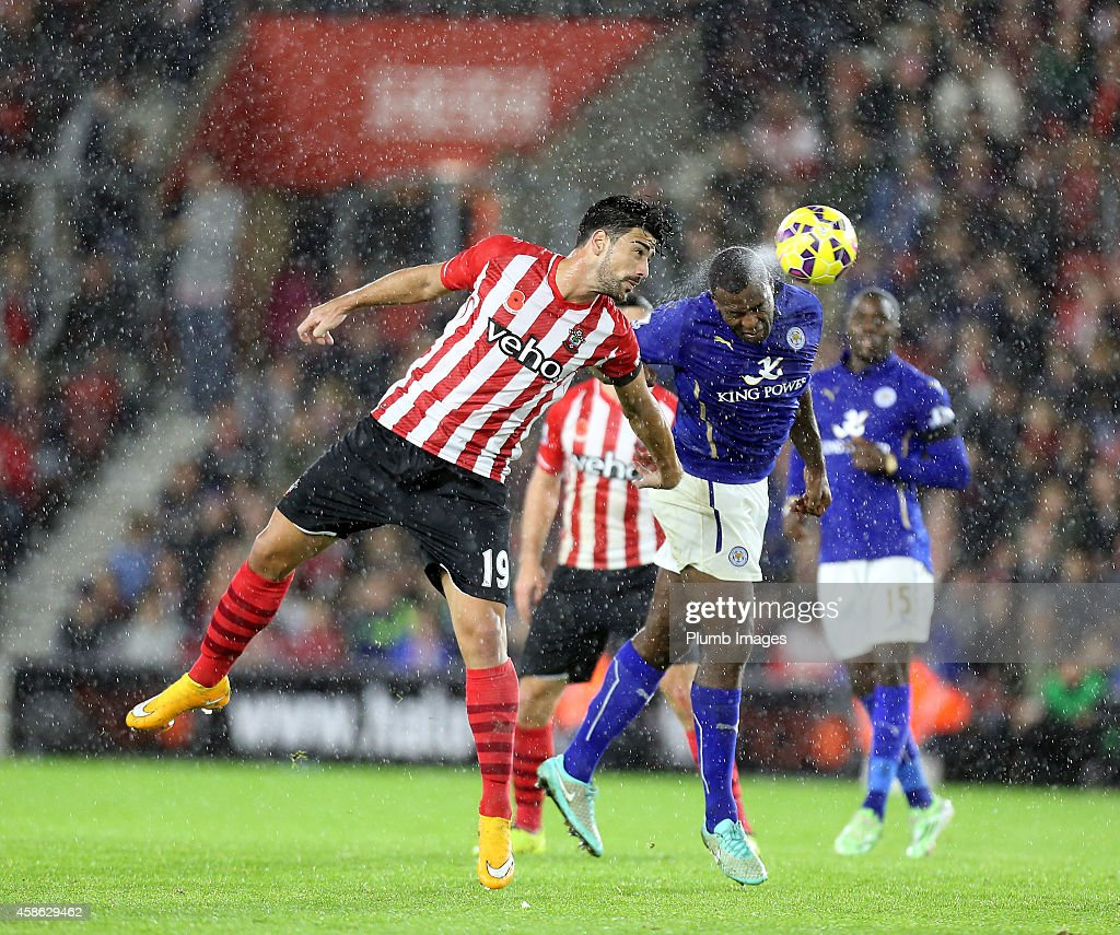 Leicesters Wes Morgan with Southampton's Graziano Pelle during the Barclays Premier League match between Southampton and Leicester City at St Mary's Stadium on November 8, 2014 in Southampton, England.