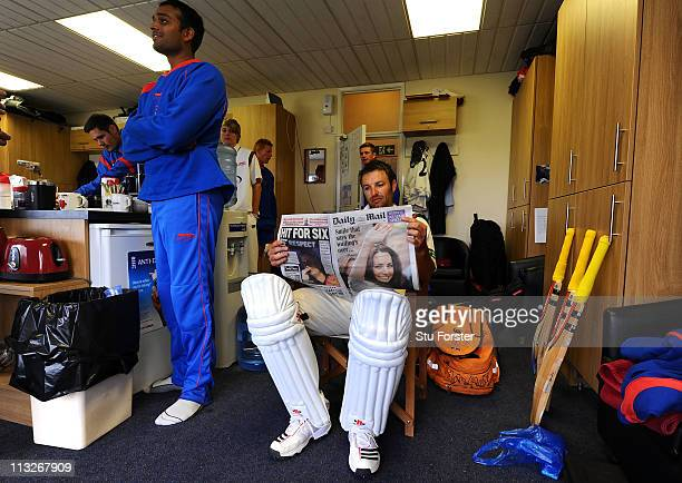 Leicestershire batsman Jacques Du Toit reads about the royal wedding whilst waiting to bat whilst his Leicestershire teammates watch the Royal...