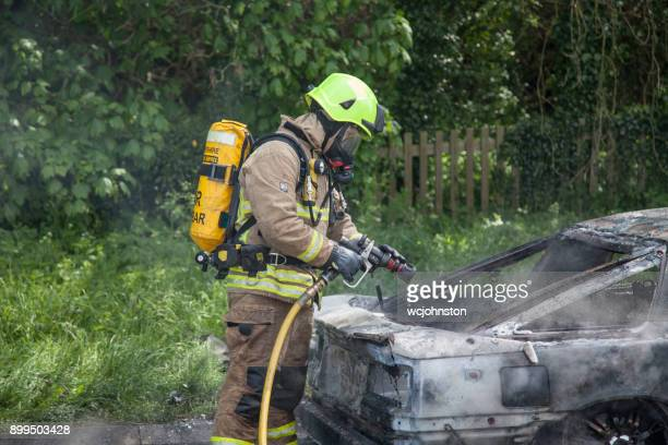 Leicestershire Firefighter in a haze of smoke Car on Fire.
