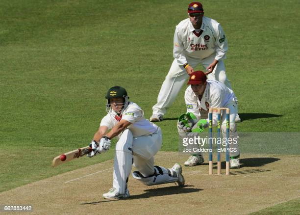 Leicestershire's Boeta Dippenaar sweeps the ball past Northamptonshire wicketkeeper Niall O'Brien