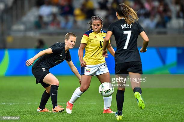 Leicy Santos of Colombia and Katie Duncan and Ali Riley of New Zealand battle for the ball during a match between Colombia and New Zealand as part of...