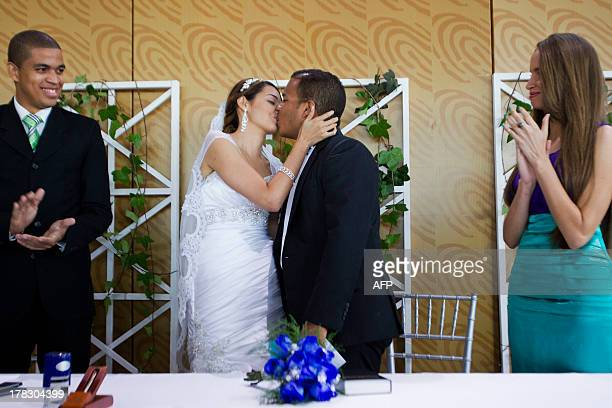 Leidy Laura Cabreja and Baldwin Rodriguez both Jehova's Witnesses kiss during their wedding ceremony held at the Central Electoral Board on August 28...