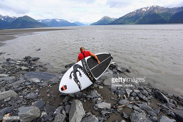 Leif Ramos puts in at his usual spot along the Seward highway as he prepares to surf the Bore Tide at Turnagain Arm on July 13 2014 in Anchorage...