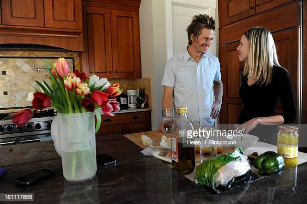 Leif Steiner and his girlfriend Katie Menke share lunch together at their rental home in Boulder Leif lost his entire home during the Fourmile Canyon...