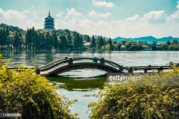 leifeng pagoda in hangzhou, china and stone bridge on the lake - hangzhou stock pictures, royalty-free photos & images