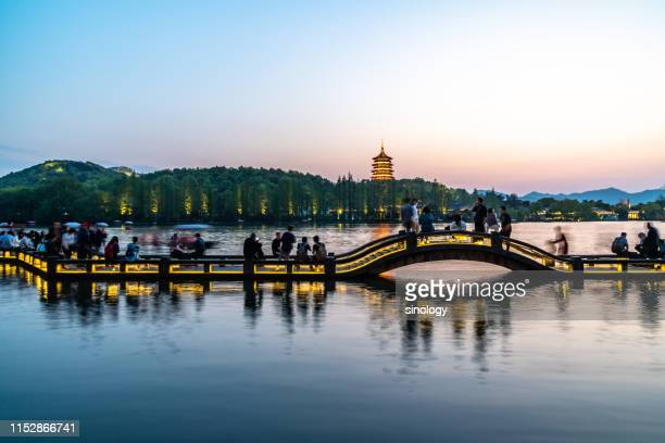 leifeng pagoda with west lake in hangzhou china - west lake hangzhou stock pictures, royalty-free photos & images
