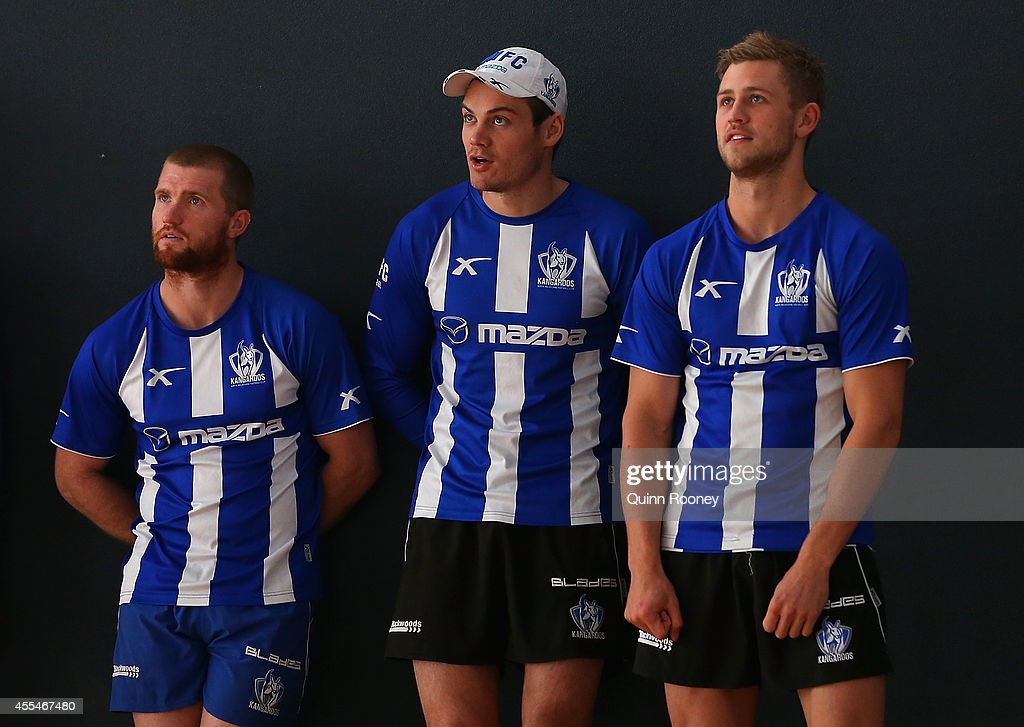 Leigh Adams, Nathan Grima and Kieran Harper of the Kangaroos watch on during a North Melbourne Kangaroos AFL training session at Arden Street Ground on September 15, 2014 in Melbourne, Australia.