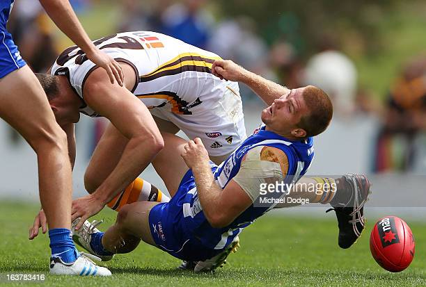 Leigh Adams of the Kangaroos gets gets hit in the head by David Hale of the Hawks when contesting for the ball during the AFL NAB Cup match between...