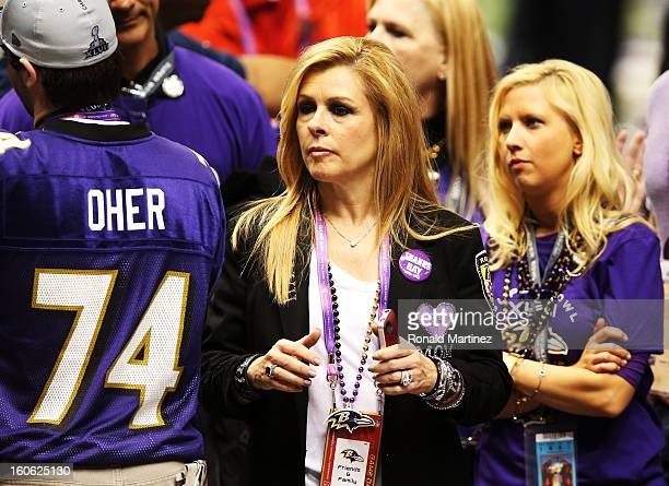 Leigh Anne Tuohy celebrates on the field after her adoptive son Michael Oher of the Baltimore Ravens and the Ravens defeat the San Francisco 49ers...