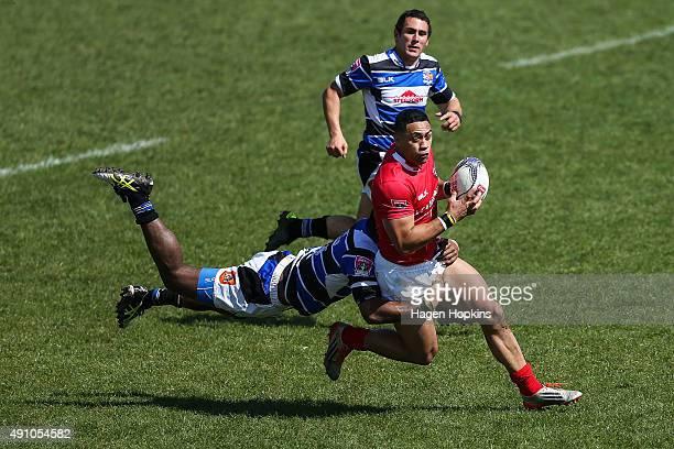 Leigh Bristow of Poverty Bay is tackled by Samu Kubunavanua of Wanganui during the round six Heartland Championship match between Wanganui and...