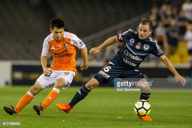 Leigh Broxham of Melbourne Victory controls the ball in front of Joe Caletti of the Brisbane Roar during Round 6 of the Hyundai ALeague Series...