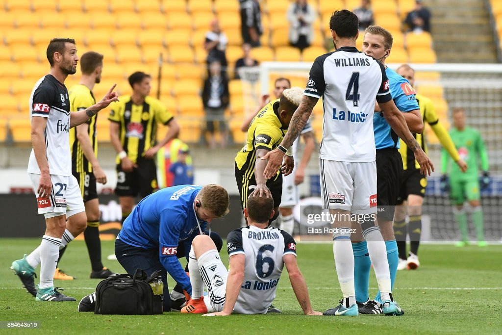 Leigh Broxham of Melbourne Victoryreceives medical attention during the round nine A-League match between the Wellington Phoenix and the Melbourne Victory at Westpac Stadium on December 3, 2017 in Wellington, New Zealand.