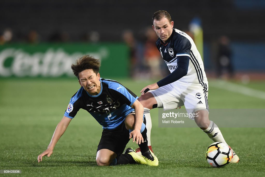 Leigh Broxham #6 of Melbourne Victory tackles Kyohei Noborizato #2 of Kawasaki Frontale during the AFC Champions League Group F match between Kawasaki Frontale and Melbourne Victory at Todoroki Stadium on March 7, 2018 in Kawasaki, Kanagawa, Japan.