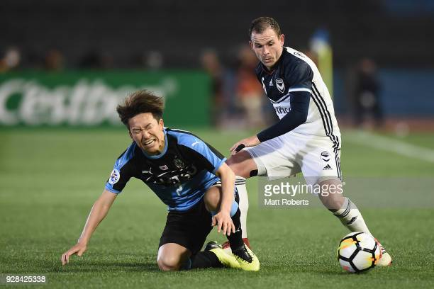 Leigh Broxham of Melbourne Victory tackles Kyohei Noborizato of Kawasaki Frontale during the AFC Champions League Group F match between Kawasaki...